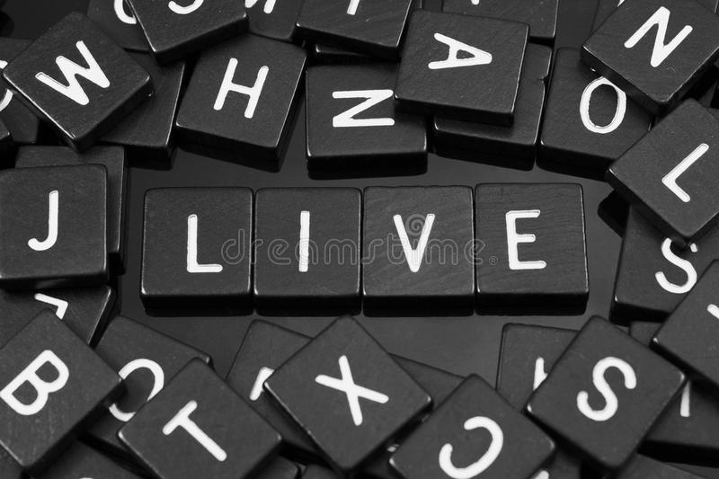 Black letter tiles spelling the word & x22;live& x22; royalty free stock image