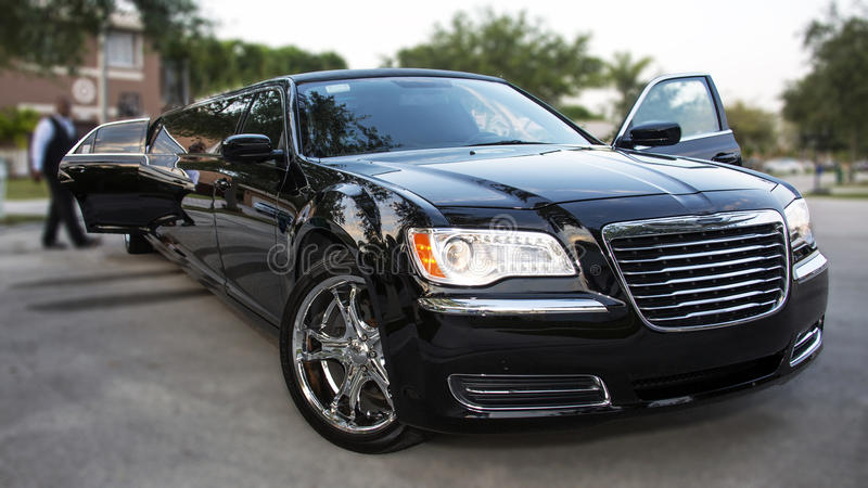 Black Limousine. A shiny limo ready for a special event royalty free stock photo