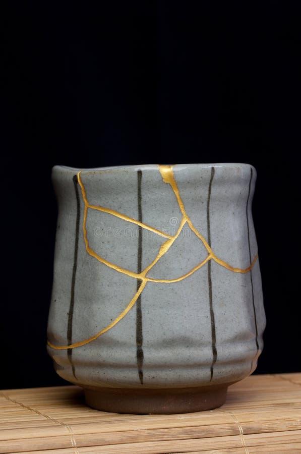 Black Lined Gold Kintsugi Cup stock images
