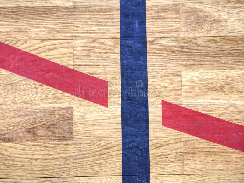 Black lines in play court on wooden lamino floor. Worn out stock images