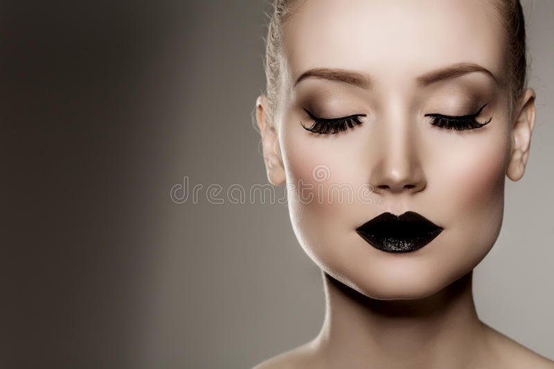 Black lips. Halloween Makeup. Luxury beautiful woman with dark l stock images