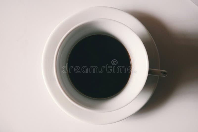 Black Liquid in White Ceramic Mug royalty free stock photo