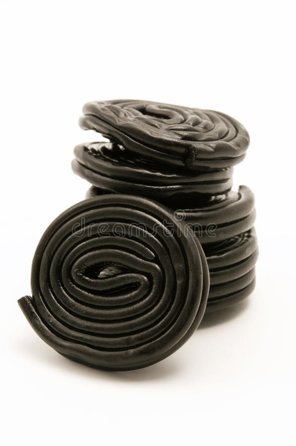 Black liquorice wheels royalty free stock photo