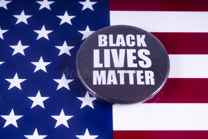 Black Lives Matter Badge over the USA Flag. LONDON, UK - MARCH 18TH 2018: A Black Lives Matter badge over a US flag background, on 18th March 2018. BLM is an royalty free stock photos