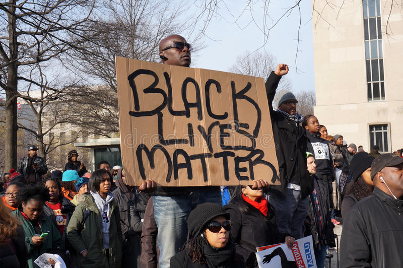 Black Lives Matter. Photo of protesters downtown at pennsylvania avenue in washington dc on 12/13/14. This man holds a sign that says black lives matter in royalty free stock images