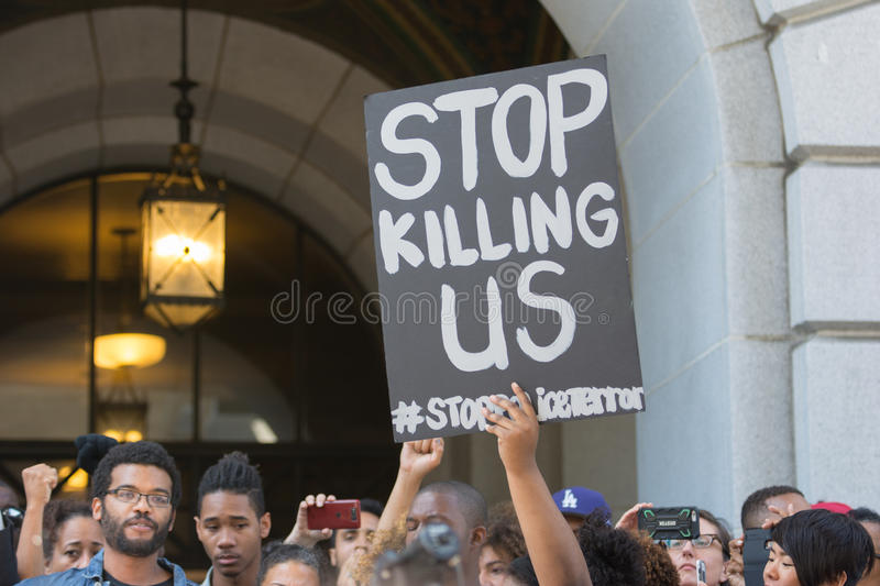 Black lives matter protestors holding a poster during march on C. Los Angeles, USA - July 12, 2016 - Black lives matter protestors holding a poster during march stock photos
