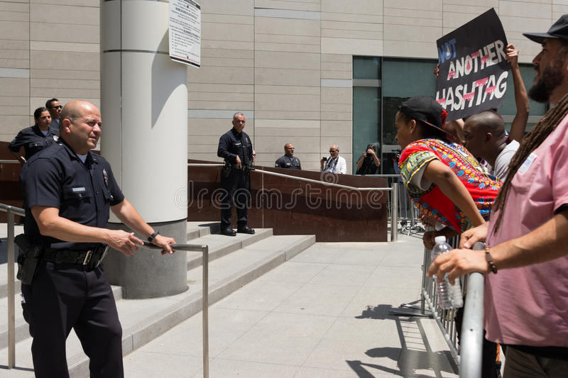 Black lives matter protestors and police during march on City Ha. Los Angeles, USA - July 12, 2016 - Black lives matter protestors and police during march on stock image