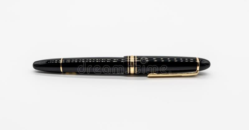 Black luxury pen isolated on white background stock image