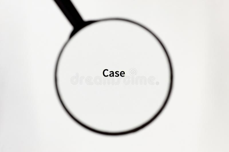 Black magnifier magnifies the inscription on a white sheet of paper. Black magnifier increases the inscription on a white sheet, mock up royalty free stock photography