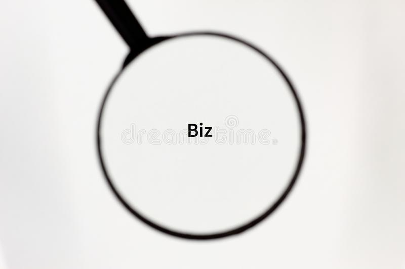 Black magnifier magnifies the inscription on a white sheet of paper. Black magnifier increases the inscription on a white sheet, mock up stock image