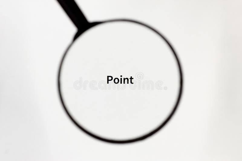 Black magnifier magnifies the inscription on a white sheet of paper. Black magnifier increases the inscription on a white sheet, mock up royalty free stock photos