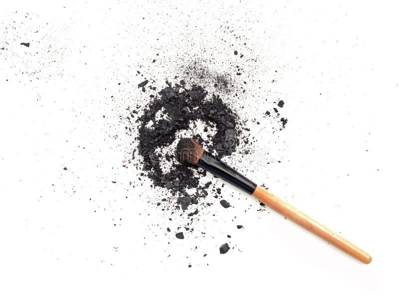 Black make up color. Make up eyeshadow with brush. Isolate on white royalty free stock photo