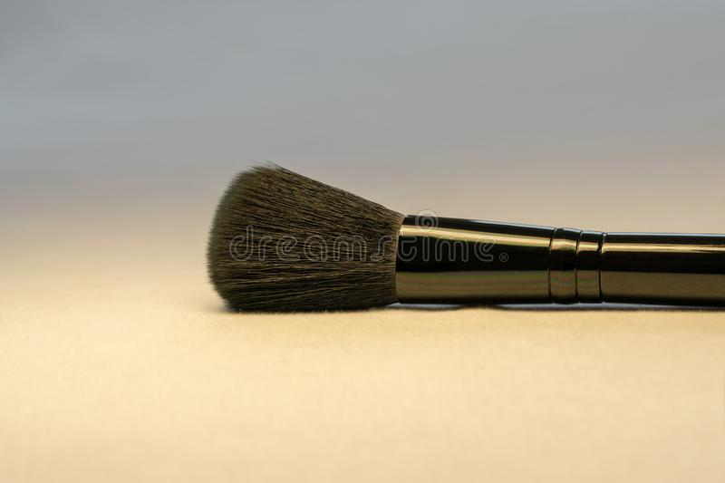 A black makeup complexion brush on light background close up picture. Beauty and Skin care concept.  royalty free stock photo