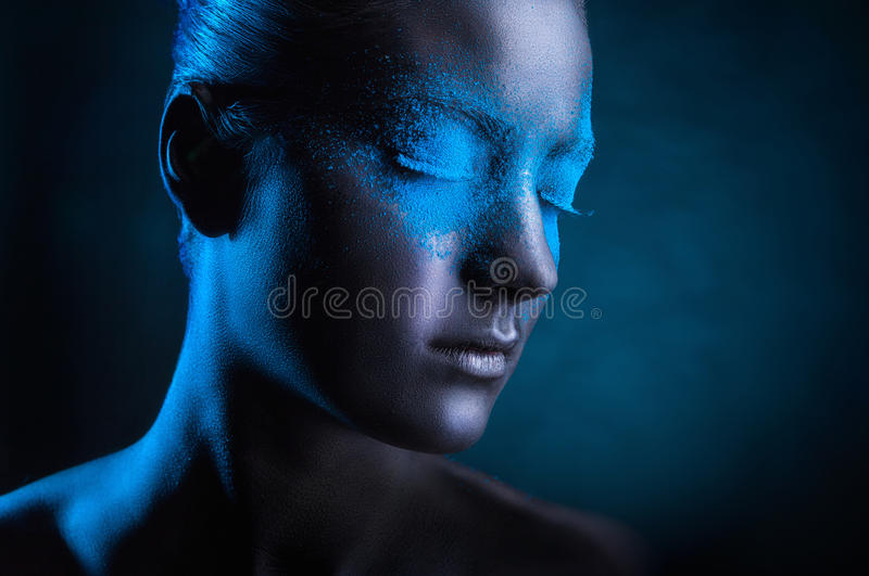 Black makeup. Young woman with black makeup and blue eye shadows stock images