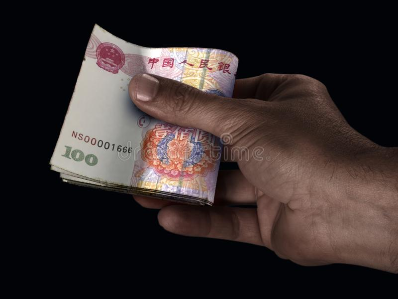 Black Hand And Yuan Cash royalty free stock image