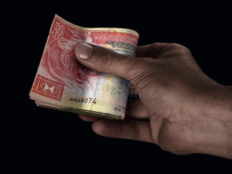 Black Hand And HK Dollar Cash stock photo