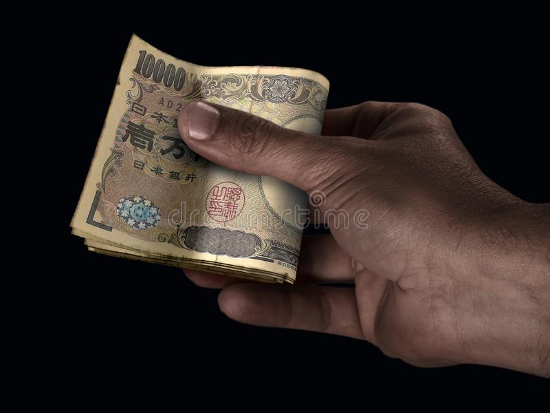 Black Hand And Yen Cash royalty free stock photos