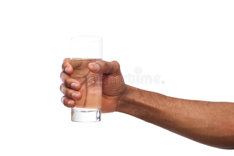 Black male hand holding glass of water isolated on white. Background, closeup, cutout stock photos