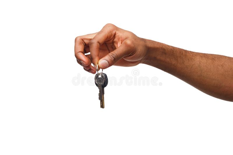 Black male hand holding key to your dream stock image