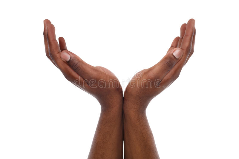 Black male hands keeping in cupped shape, cutout. Charity, protection and care concept. Black male hands keep empty cupped palms together isolated on studio royalty free stock photography