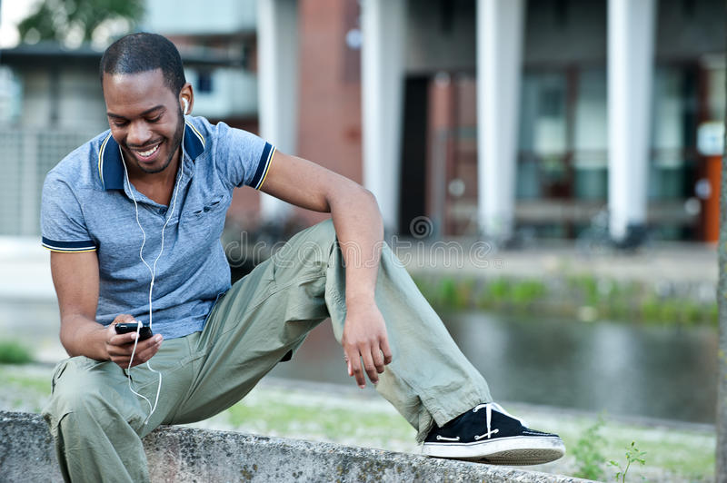 Black Male Listening To Music On Mp3 Stock Photography