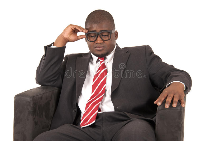 Download Black Male Model Pondering While Sitting Is Chair Wearing A Suit Stock Photo - Image: 34335962