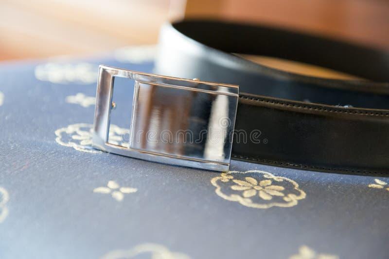 Black man belt. A black man belt with silver buckle stock image