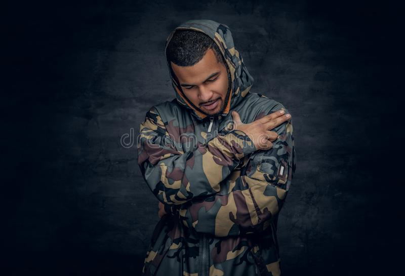 Black man dressed in military jacket. stock photos