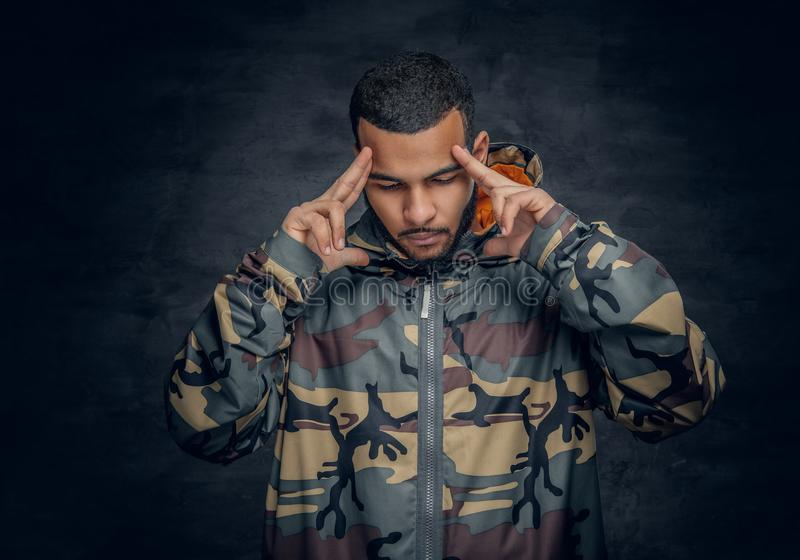 Black man dressed in military jacket. stock image