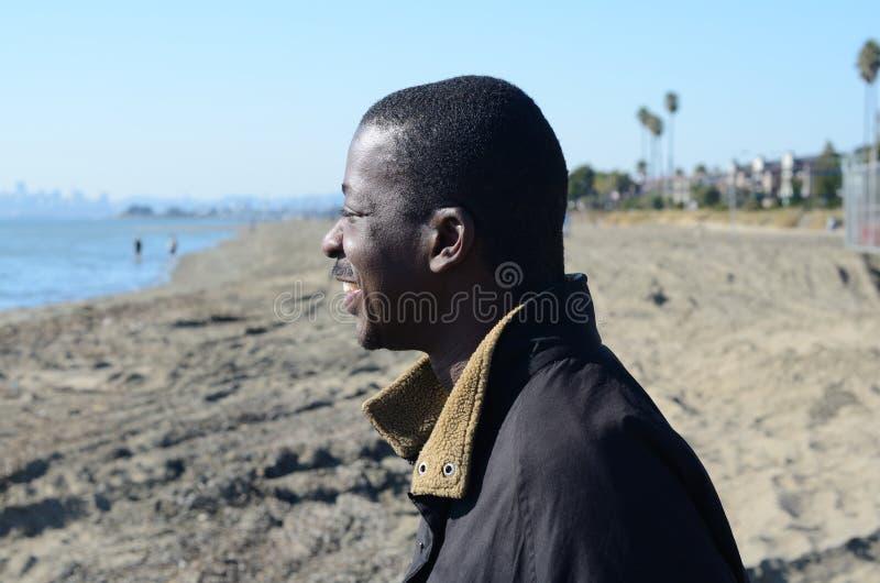 Download Black Man Gazing Into The Ocean Stock Photo - Image: 35033526