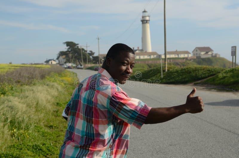 Black Man Hitchhiking. At the Coast of California stock image