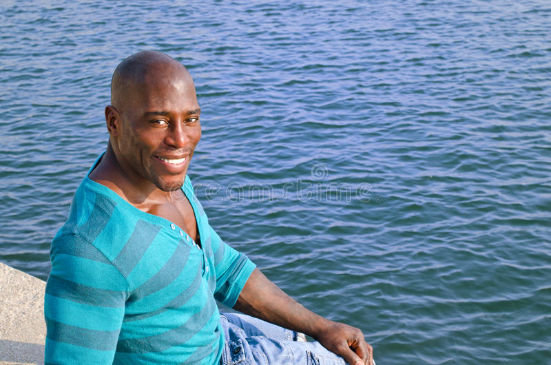Download Black Man Relaxing At The Edge Of The Pool. Stock Image - Image: 32430221
