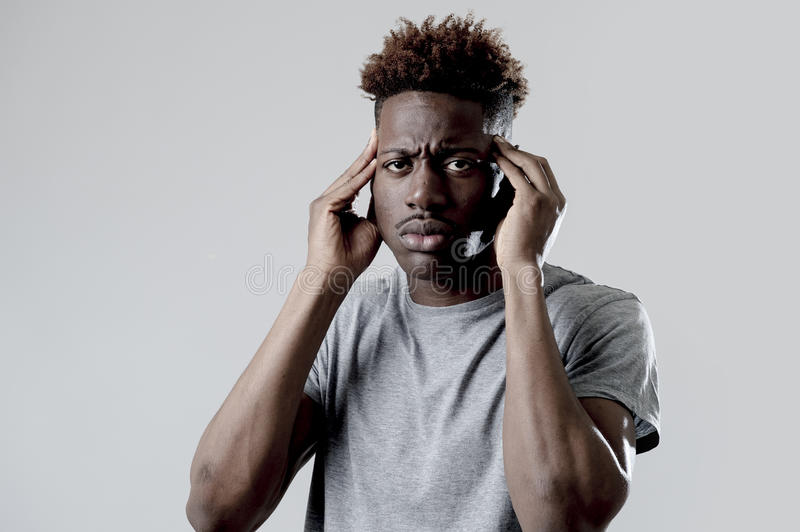 Black man in sad and tired face expression looking exhausted suffering headache. Young attractive afro american black man in sad and tired face expression stock images