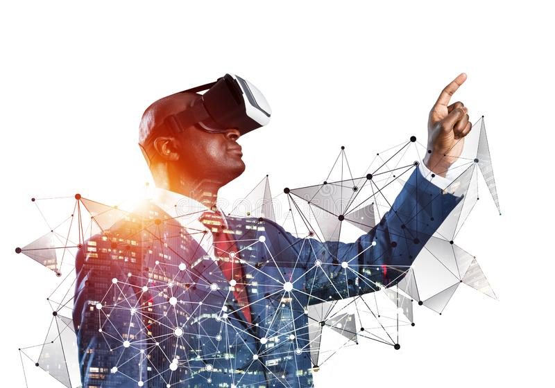 Black man standing with VR headset stock image