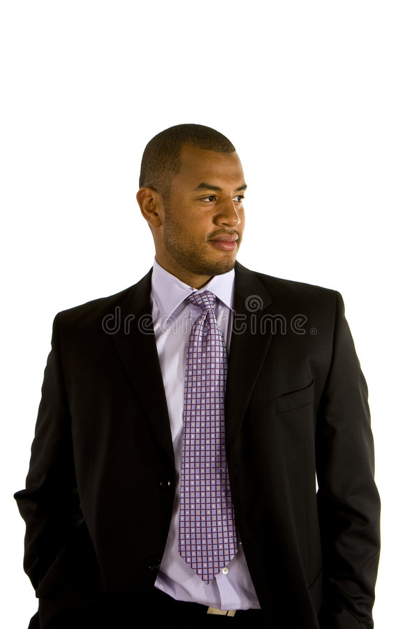 Black Man In Suit Hands In Pockets Looking To Side Stock Image