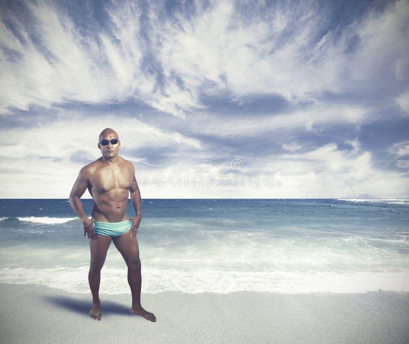 A black man on tropical beach. A black man on the tropical beach stock photo
