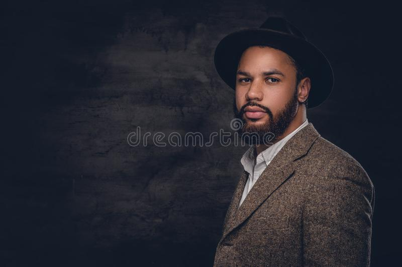 Black man wearing a suit and a felt hat. stock photos