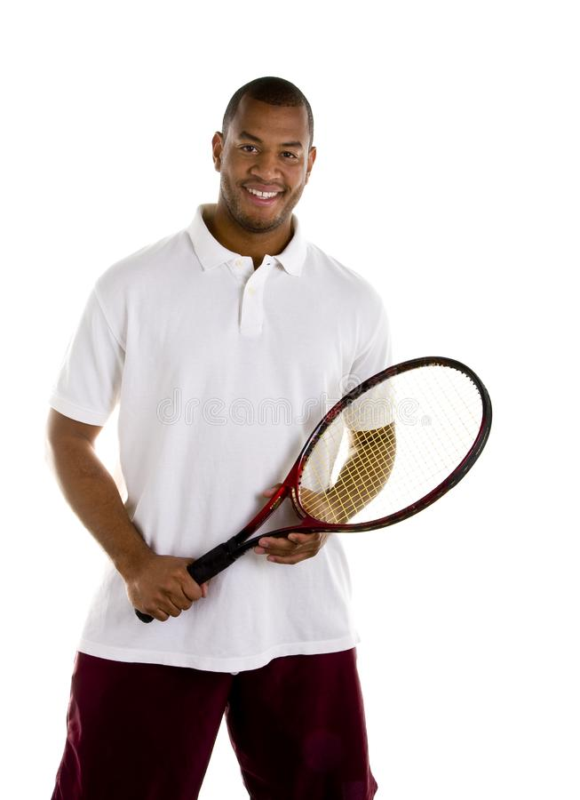 Black Man in White Shirt with Tennis Racket stock photography