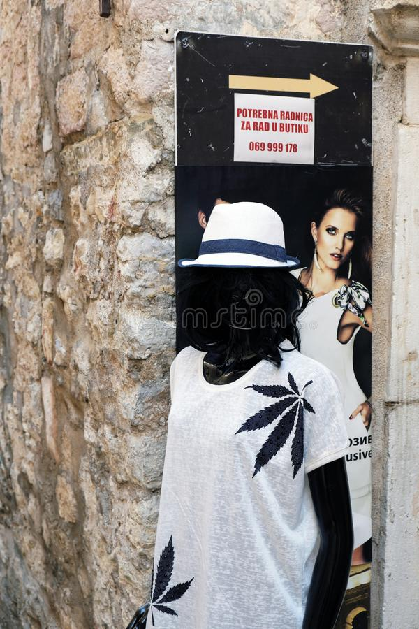 Black Mannequin Wearing White Dress and Hat royalty free stock photography