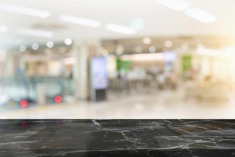 Black marble table top on blur coffee shop. Window background. For product or foods montage royalty free stock image