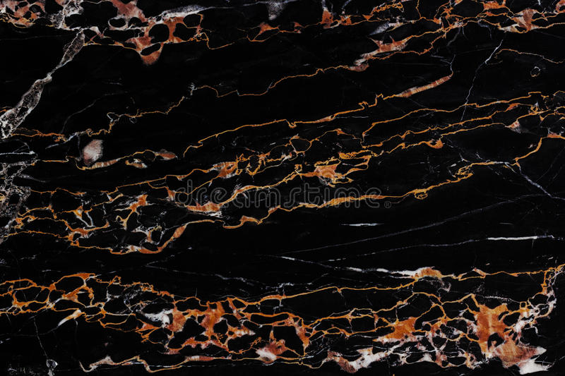 Black marble texture. Black and gold natural marble flat surface close-up texture stock photography