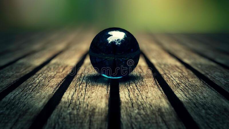 Black marble on wooden planks royalty free stock image