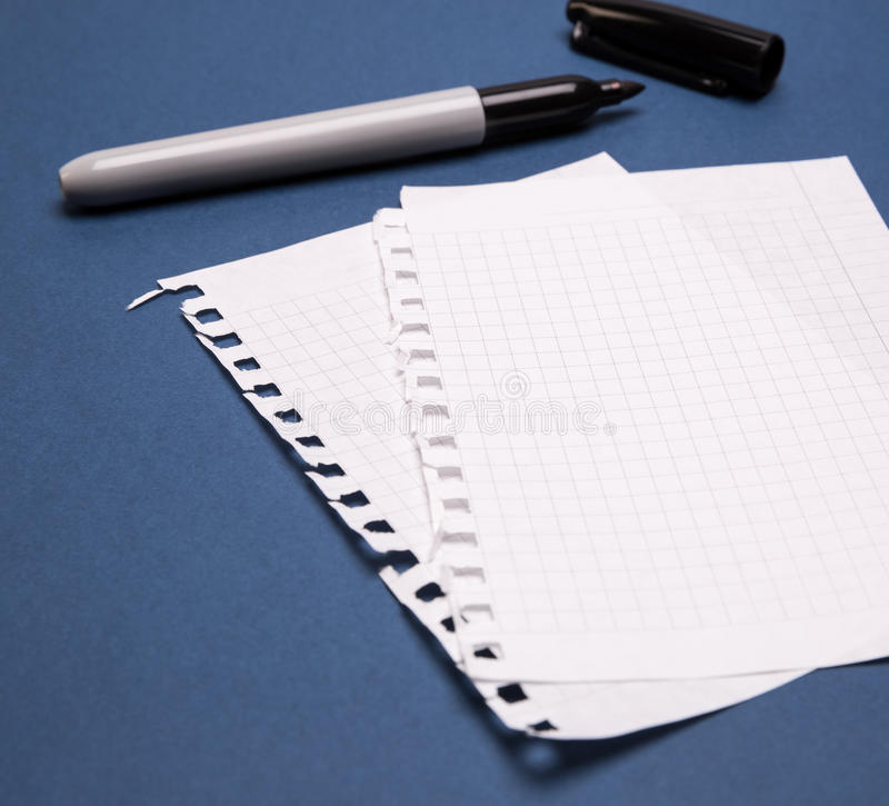 Black marker and sheets stock image