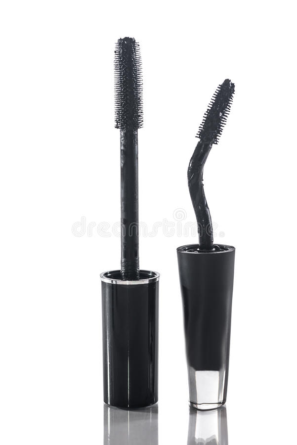 Mascara with applicator brush isolated on white. Black mascara with applicator brush isolated on white stock photo