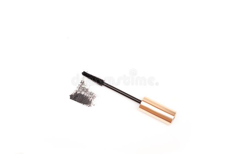 Black mascara brush stroke with applicator brush isolated on white background royalty free stock photography