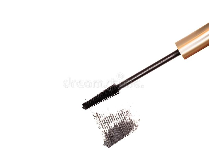 Black mascara brush stroke with applicator brush isolated on white background.  royalty free stock photography