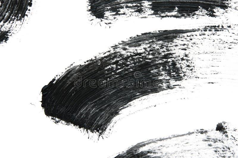 Black mascara brush strokes isolated on white. Image royalty free stock photo