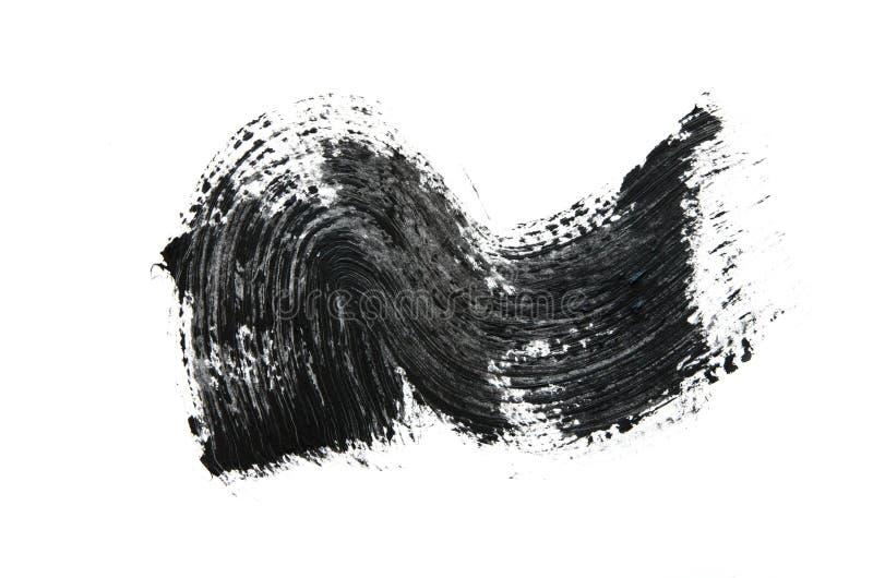 Black mascara brush strokes isolated on white. Image royalty free stock photos