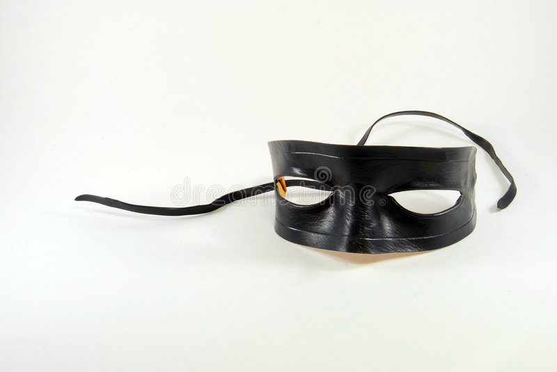 Black Mask. Black leather Lone Ranger type mask on a white background stock photography