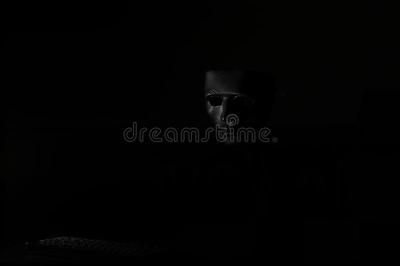 Black mask in the dark ritual and mystery. Black mask in the dark secretive ritual and mysteryr royalty free stock image